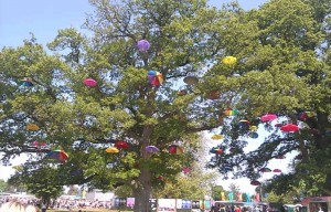 Umbrellas decorate the tress at Radio 1's Big Weekend.