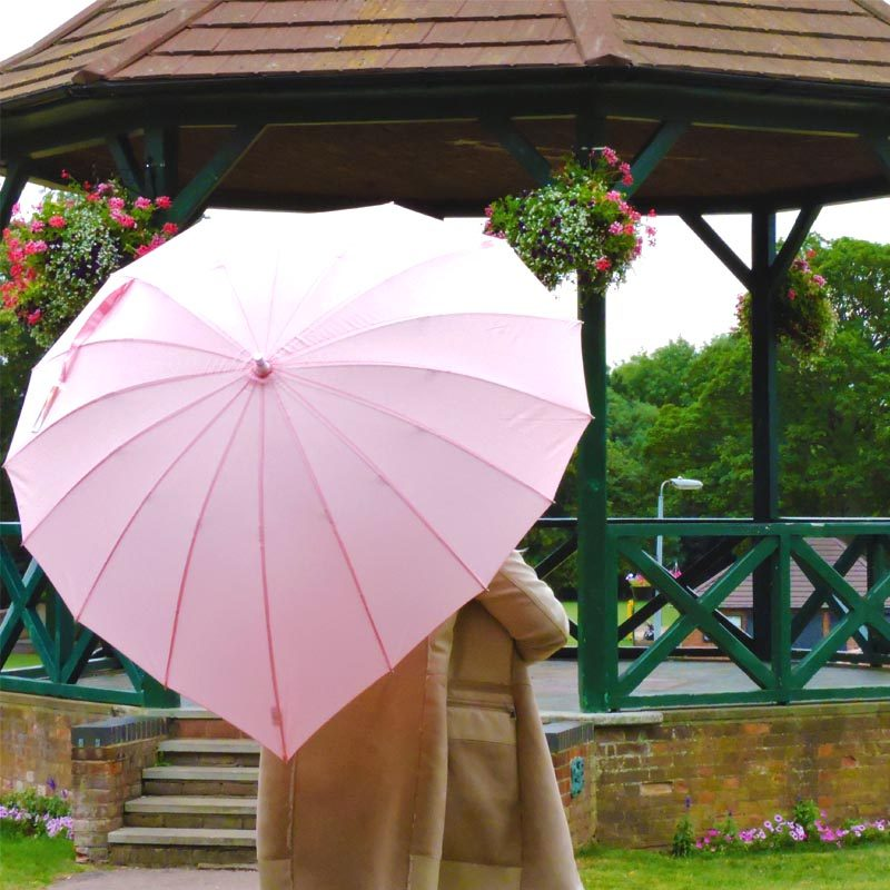 Heart Shaped Umbrellas soft pink heart shaped umbrella in the park