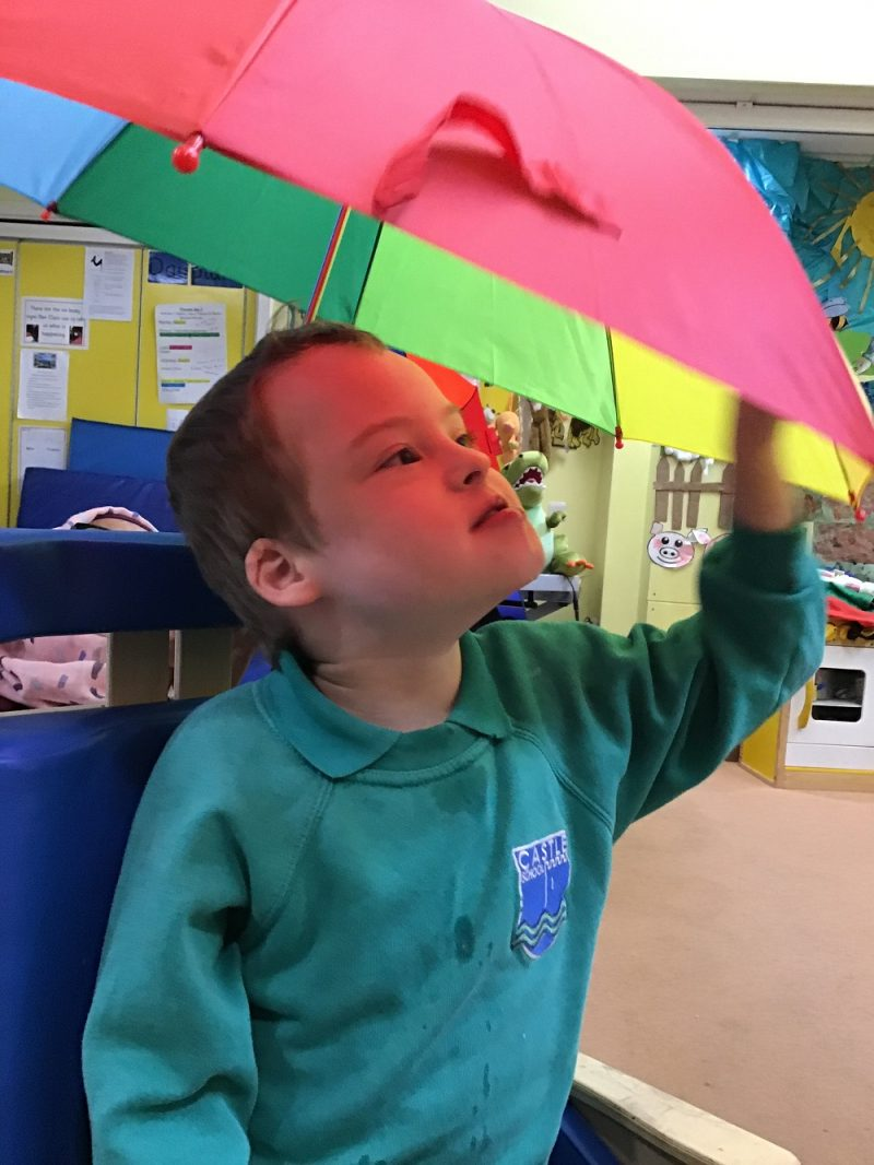 kids rainbow umbrellas at school