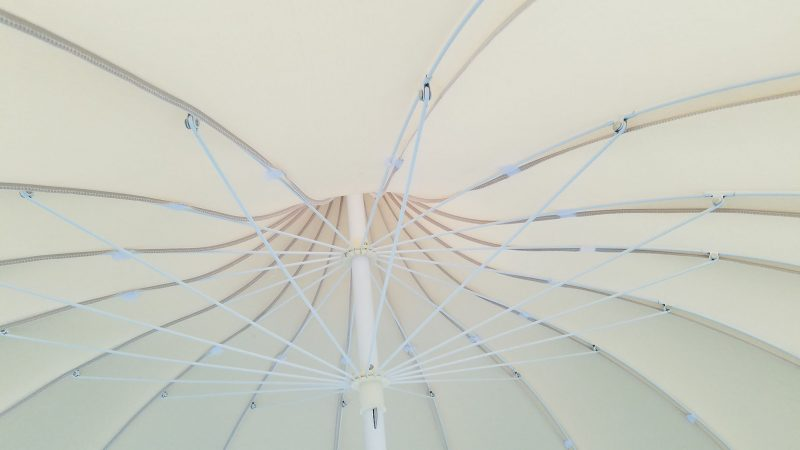 Underside of natural pagoda patio umbrella