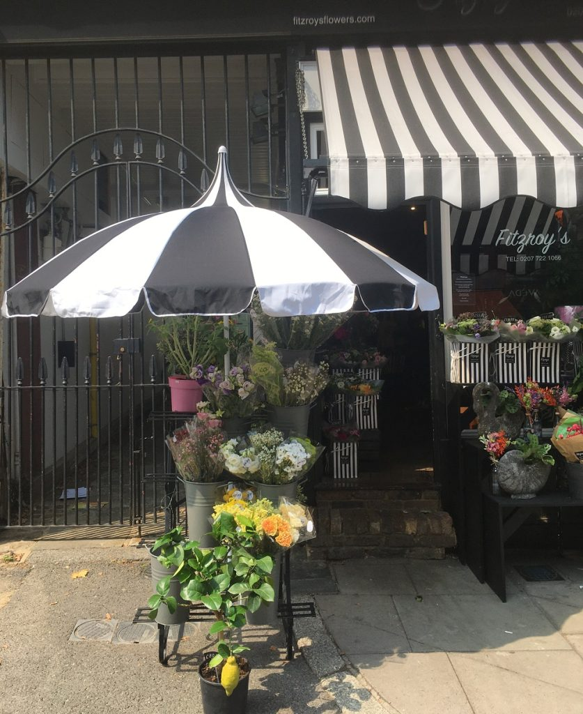 black and white patio pagoda umbrella outside Fitzroys flower shop